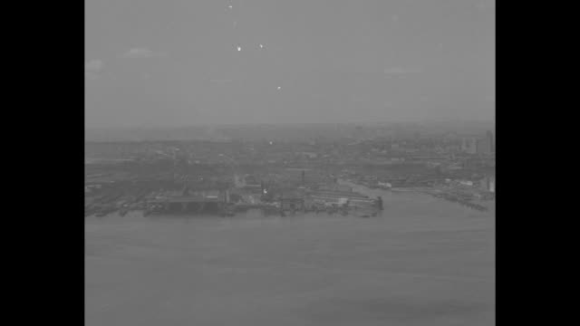Birdseye view Jersey City across Hackensack River / pan of Jersey City along the Hackensack River can see Roosevelt Stadium in the distance / Jersey...