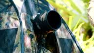 Birdwatcher taking bird photo