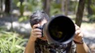 Birdwatcher taking photo of bird