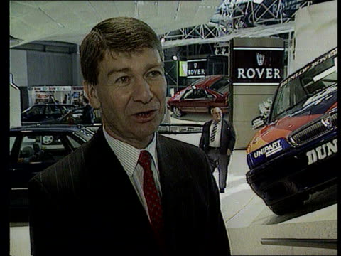 INT GV Rover car on display at motor show ZOOM IN MS Car on display John Towers interviewed SOT The only thing that has changed here is the shares...