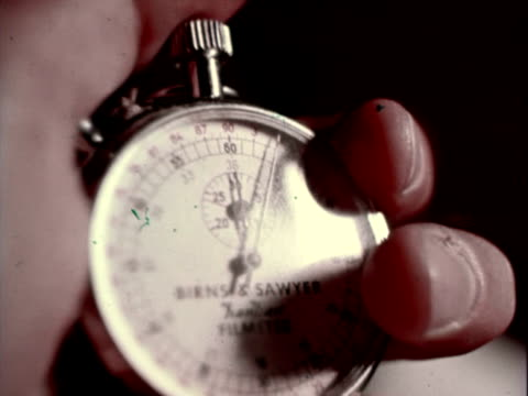 Birns and Sawyer filmeter analogue stopwatch in man's hand CU Stopwatch on January 01 1960