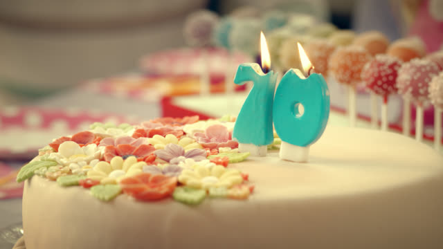 Birthday candles on the cake being blown out