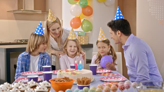 Birthday girl making a wish