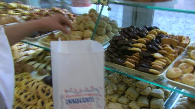 Biscotti shop owner bagging cookies