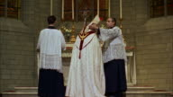 MS Bishop and assistants at altar