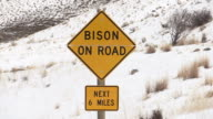 Bison caution sign, Yellowstone National Park, Wyoming, in winter