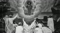 Black and white 1914 composite wide shot Jesus standing before crowd and halo appearing / ascending into heaven on cloud