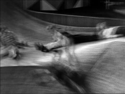 Black and white 1940 children sliding down large slide, running into each other / Coney Island, NY / industrial