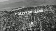 1930 black and white Aerial view of 'Hollywoodland' sign / Los Angeles, California