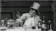 1906 black and white medium shot man (Jack Brawn) eating Welsh Rarebit / doing 'spit take' / 'Dream of a Rarebit Fiend'