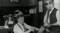 1921 black and white medium shot man (Eddie Lyons) yelling at clerk in office / clutching hair / 'Peace and Quiet'