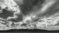 Black and white timelapse of clouds moving over mountains in Idaho