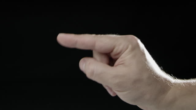 Black background hand signs language slow motion caucasian human