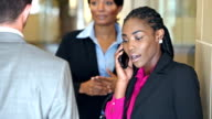 Black business women talking to man, making phone call