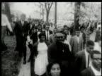 Black crowd walking in protest of segregation / Alabama United States