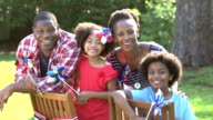 Black family, two children playing on American holiday