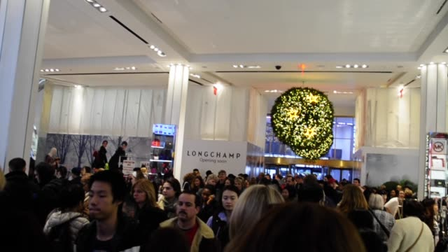 Black Friday Friday following Thanksgiving Day Shoppers in Macy's department store at Herald Square 34 Th Street Manhattan New York City USA Black...