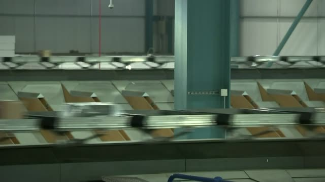 Most shopping done online Oldham Workers packing orders in online distribution centre Items along conveyor belts Worker packing order Alex Baldock...