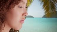 Black girl looks at the Caribbean ocean