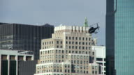 A black helicopter comes in for a landing on the lower east side of Manhattan.