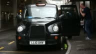 A black London taxi cab sits with light illuminated showing it is available for a fare at Heathrow Airport in London UK on Wednesday May 28 Close...
