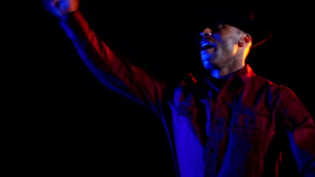 Black male disc jockey plays the music