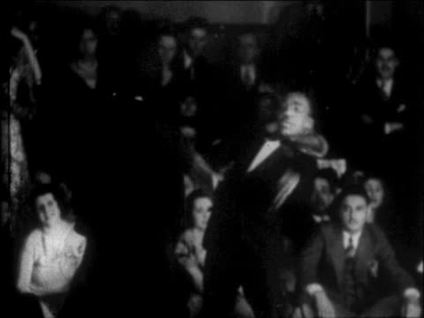 B/W 1927 Black man doing somersault + dancing on floor in Harlem nightclub / NYC / newsreel