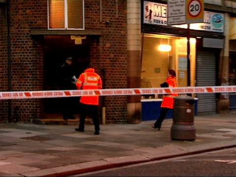 Black man shot dead in Operation Trident ENGLAND London Ealing Police cordon tape around crime scene as police officers along Cordoned off street