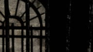 Black metal bars on a cold stone prison cell