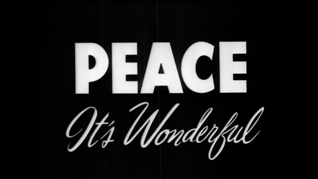 / Black screen / the word 'PEACE' appears in the center of the screen / the phrase 'It's Wonderful' appears underneath the word PEACE WWII 'Peace...