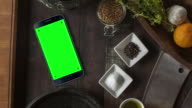 Black Smartphone on Desk Chroma Key Green Screen
