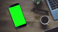 Black Smartphone on Desk with Chroma Key Green Screen