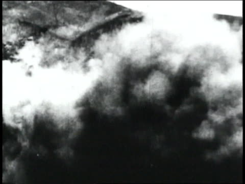WS black smoke and rubble rolling down a hill as though from an explosion / Republic of Panama