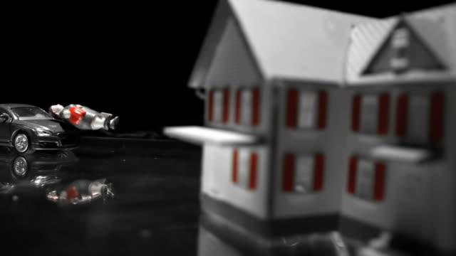Black toy car hitting a woman figurine