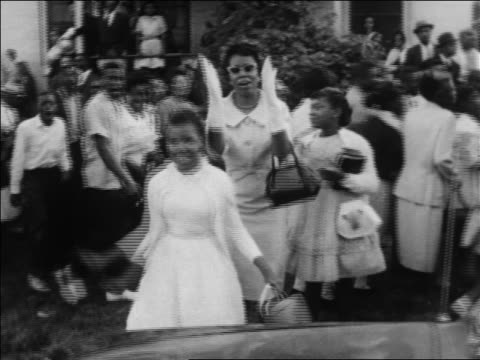 Black woman 2 girls cheer on marchers at civil rights demonstration / Alabama / newsreel