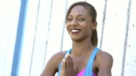 Black woman doing yoga exercises, prayer pose