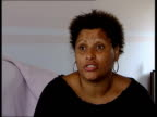 Black woman offered white artificial limb ITN Berkshire Ingrid Nicholls on stair lift as along up stairs in house Ingrid Nicholls interviewed SOT...