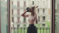 Black woman with horse head on the balcony