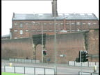 TUC conference Hindley Prison EXT Prisoners seen waving from behind barred windows / Prison building seen behind wall / Prison Officer walking along...