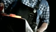 HD SLOW MOTION: Blacksmith Hammering A Horseshoe