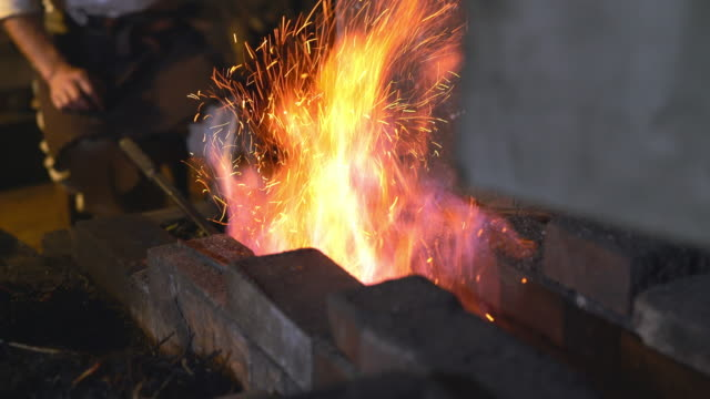 Blacksmith in his forge