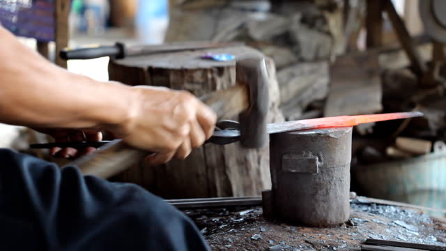Blacksmith making knife