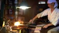 Blacksmith moulding hot metal block