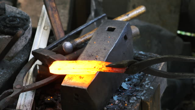 Blacksmith shaping a traditional Japanese cooking knife