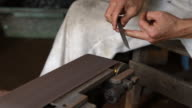 Blacksmith sharpening blade