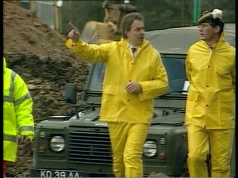 Blair Under Pressure to Call Off May Elections LIB Dumfries Galloway Nr Lockerbie Tony Blair wearing yellow protective suit as along inspecting...