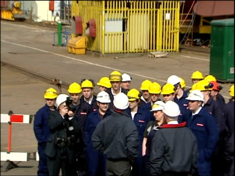 Blair walkabout in Govan Blair Emery McConnell workers and halfcompleted HMS Diamond in background Blair having his microphone fixed then embarking...