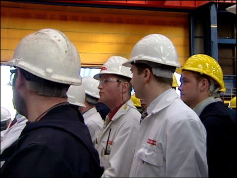 Blair walkabout in Govan Blair McConnell and others shaking hands with staff and away Workers chatting