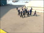 Glasgow Govan Shipyard EXT Tony Blair MP along wth Jack McConnell Vic Emery and others then shaking hands with young male and female apprentices and...