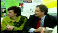 Blairs visit adoption centre ENGLAND London Coram Family Centre INT GVS Tony Blair MP and wife Cherie sitting chatting to carers in adoption centre /...